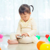 Little girl using mobile phone — Stock Photo
