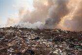 Burning garbage heap of smoke — Stock Photo