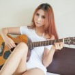 Sexy girl with a guitar — Stock Photo #46636785
