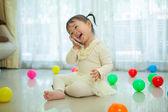 Little girl talking on mobile phone — Foto Stock