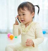 Little girl talking on mobile phone — Stock Photo