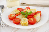 Salad with artichoke on the white plate — Stock Photo