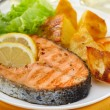 Fried salmon with lemon and potato — Stock Photo #13387889