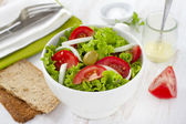 Vegetable salad in white bowl — Stock Photo