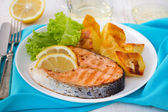Fried salmon with lemon and potato — Stock Photo