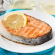 Fried salmon with lemon on the plate — Stock Photo