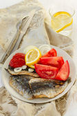 Fried filet of sardines with onion — Stock Photo
