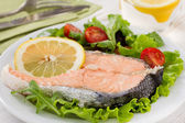Boiled salmon with lemon — Stock Photo