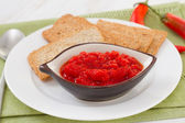 Pepper sauce with toasts — Stock Photo
