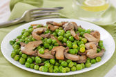 Green peas with mushrooms — Stock Photo