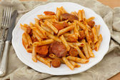 Penne with chorizo and sauce — Stock Photo