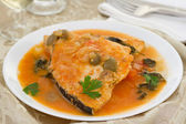 Fish in sauce on the plate — Stock Photo