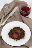 Black beans with chorizo and boiled rice — Stock Photo
