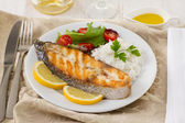 Grilled fish with rice, lemon and salad — Stock Photo