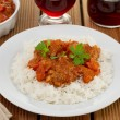 Meatballs with boiled rice on the white plate — Stock Photo