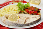 Boiled fish with vegetables, salad and mashed potato — Stock Photo