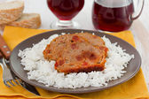 Roll of meat with boiled rice on the plate — Stock Photo