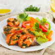 Fish with seafood and salad on the plate — Stock Photo