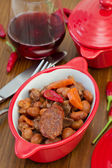Sausages with meat and beans in the bowl — Stock Photo