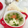 Cauliflower soup in red bowl with spoon - Stock Photo