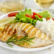 Grilled fish with rice ans salad — Stock Photo
