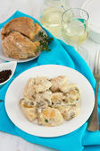 Chicken with mushrooms and sceams on the plate — Stock Photo