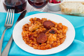 Beans with sausages and chicken in sauce on the plate — Stock Photo