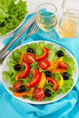 Salad with pepper, olives and lettuce on the plate — Stock Photo