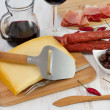 Cheese with sausages, olives and red wine — Stock Photo #18006705