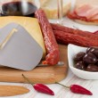 Cheese with sausages, olives and red wine — Stock Photo #18006707