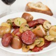 Salad with sausages and mushrooms on the plate — Stock Photo