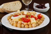Chick pea salad with cheese and tomato — Stock Photo