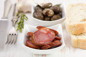 Olives with chourico, rosemary and garlic — Stock Photo