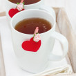 Two cups of tea with hearts — Stock Photo