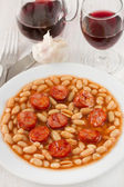 Chourico with white beans in tomato sauce — Stock Photo