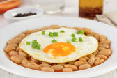 Fried egg witn onion and beans — Stock Photo