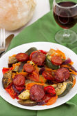 Fried sausages with vegetables on the plate — Stock Photo