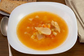 Fish soup in the white plate — Stock Photo