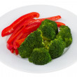 Vegetables on the plate on white background — Stock Photo