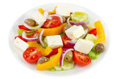 Salad with olives and cheese on the plate — Stock Photo