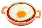 Fried egg with vegetables on dish on white background — Stock Photo