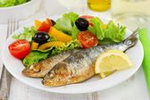 Fried sardines with fresh salad — Stock Photo