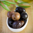 Olives in the white bowl - Stock Photo