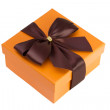 Orange box with brown bow — Stock Photo