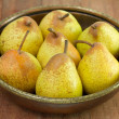 Pears in the old dish - Stock Photo