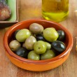 Olives in the brown bowl - Stock Photo