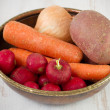 Radish with carrot, onion and potato - Stock Photo
