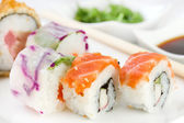 Japanese food on white dish with sauce — Stock Photo