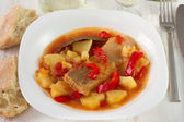 Fish stew on the white plate — Stock Photo