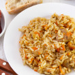 Rice with carrot and pork — Stock Photo